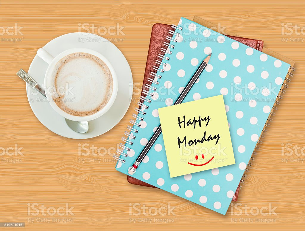 Happy Monday and smile on blank paper stock photo