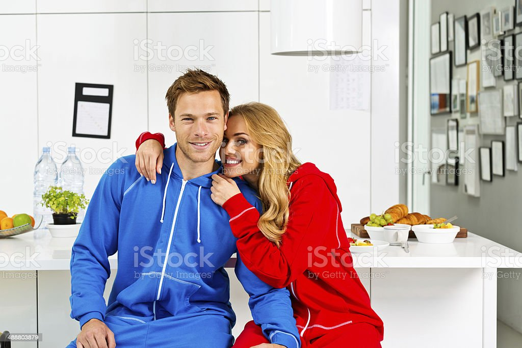 Happy morning Portrait of happy young couple sitting on chairs in the modern kitchen in the morning.  20-24 Years Stock Photo
