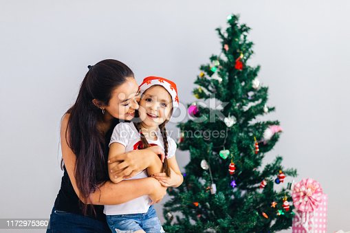 1061876006 istock photo Happy mother and daughter embrace 1172975360