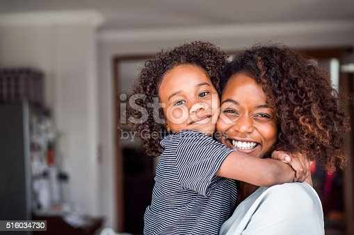 istock Happy mother and daughter embracing at home 516034730