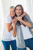 istock Happy mother and daughter embracing 671705420
