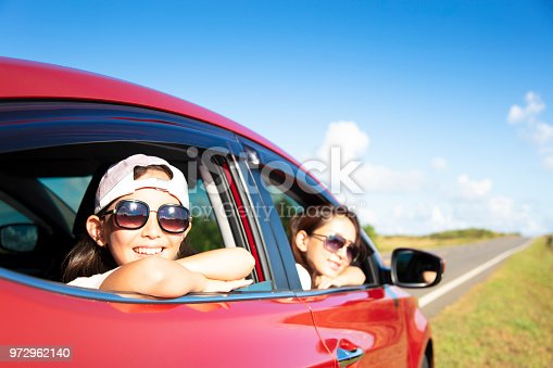 972962180 istock photo Happy mother and daughter enjoy road trip 972962140