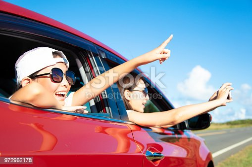 972962180 istock photo Happy mother and daughter enjoy road trip 972962178