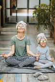 istock Happy mother and daughter exercising Yoga in the morning at home. 1135489206
