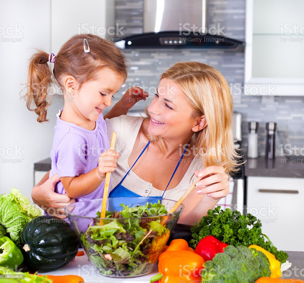 Happy mother and daughter in the kitchen royalty-free stock photo