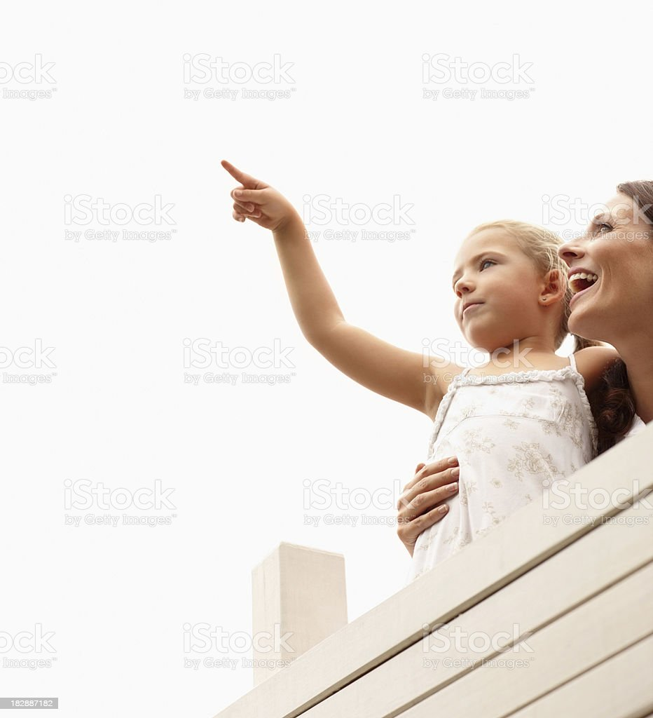 Happy mother and daughter looking at copy space royalty-free stock photo