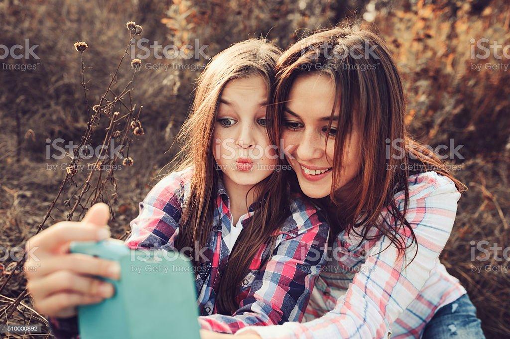 happy mother and daughter making selfie outdoor in summer stock photo