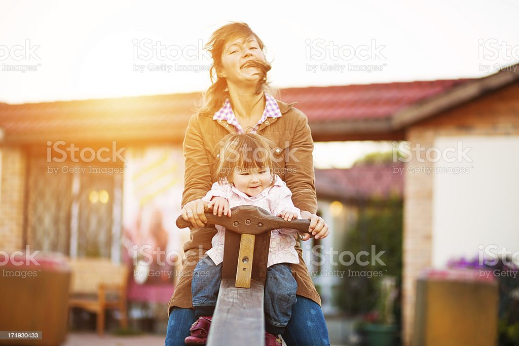 happy mother and daughter on swing royalty-free stock photo