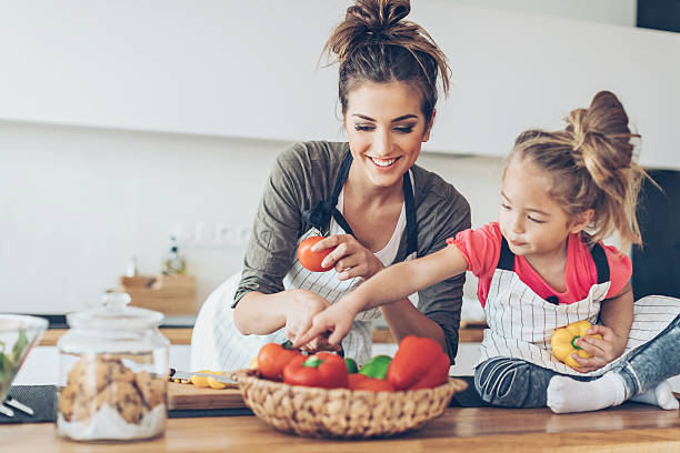 happy mother and daughter - kids cooking stock photos and pictures