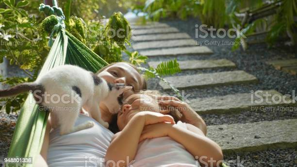 Happy mother and daughter relaxing together in a hammock at garden in picture id948801336?b=1&k=6&m=948801336&s=612x612&h=c fiukylp1x0yywc31rvpnbyv7lbhp9fljcgs2hz6dk=