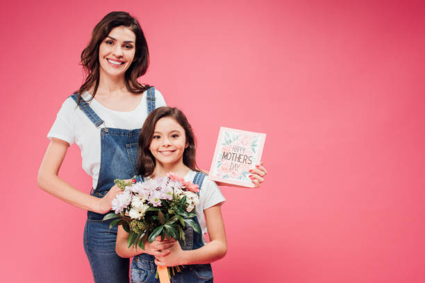 Happy mother and daughter smiling while holding flowers and greeting picture id1088964632?b=1&k=6&m=1088964632&s=612x612&w=0&h=k7ip iwnt7nu4 cbnqfyy p9cgusbtyuk 79ap7ivrw=
