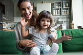 istock Happy mother and kid looking at camera recording videoblog, portrait 1028379304