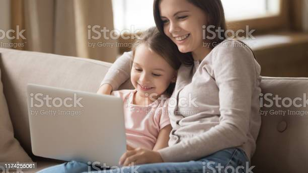 Happy mother and little daughter using laptop together at home picture id1174255061?b=1&k=6&m=1174255061&s=612x612&h=chjfm6yiibszgqy pa2vrfneeok hapzszycxmvqkke=