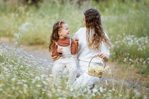 Mother and daughter having a great time in nature- Mothers day