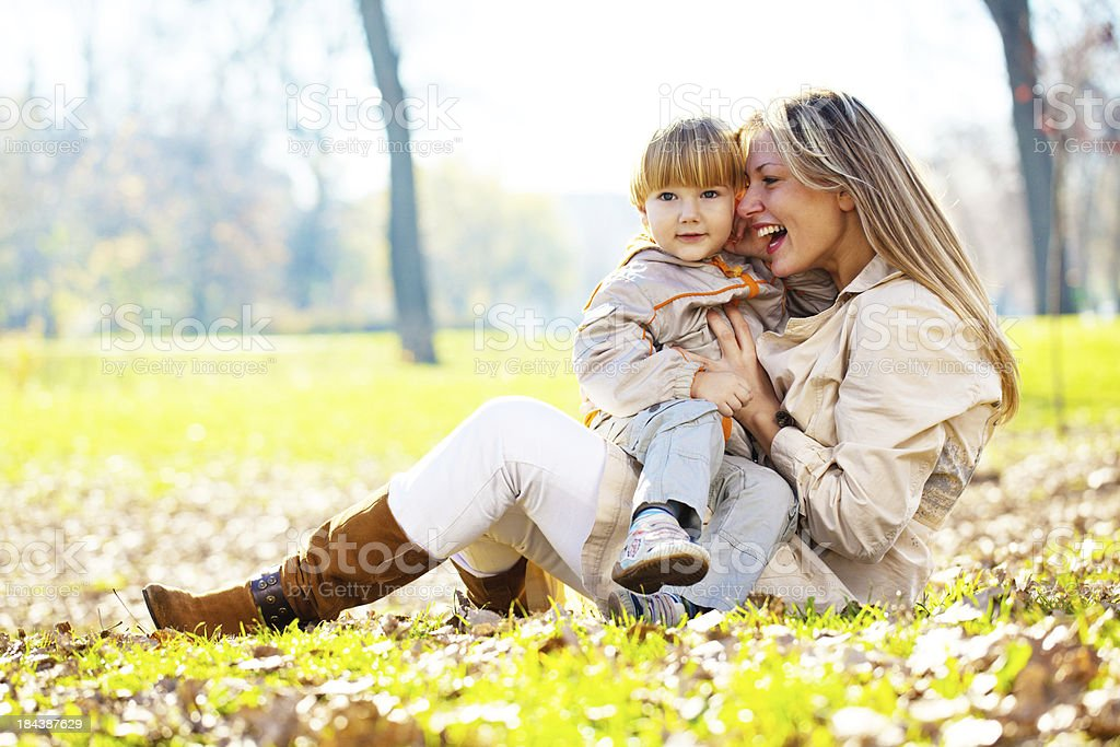 Happy mother and son, enjoying in park. royalty-free stock photo
