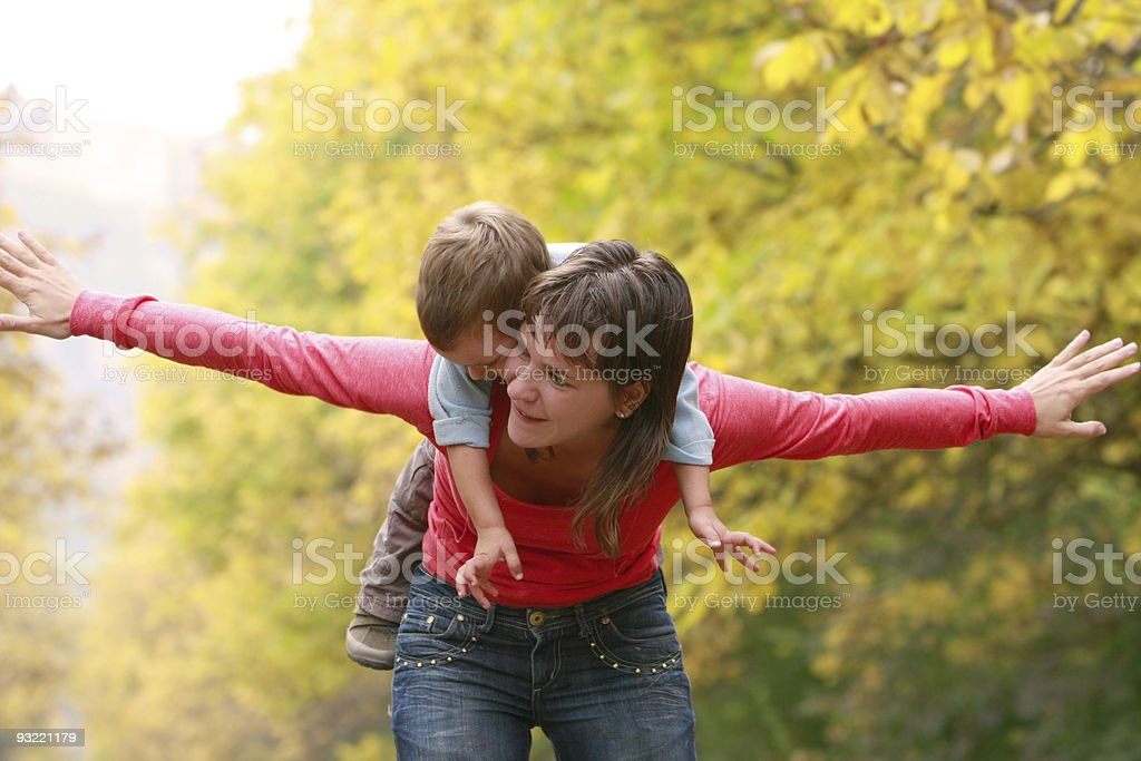 happy mother and son in autumn park stock photo
