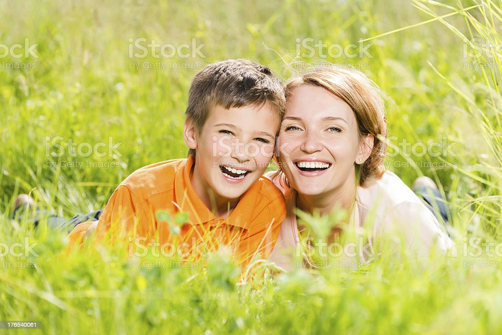 Happy mother and son in park royalty-free stock photo