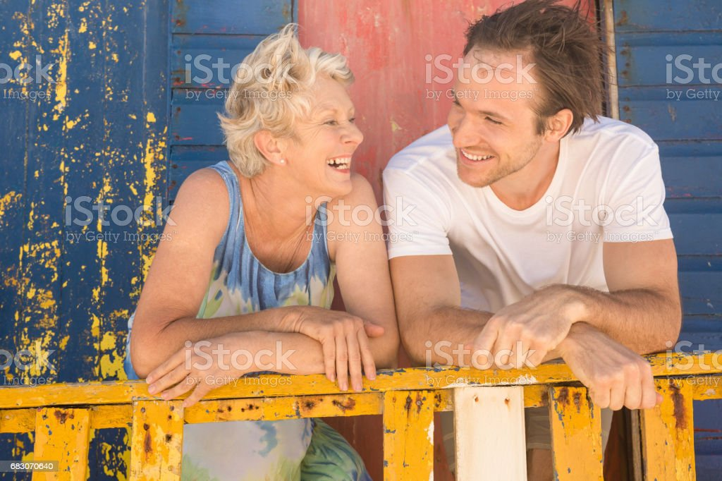 Happy mother and son leaning on railing foto de stock royalty-free