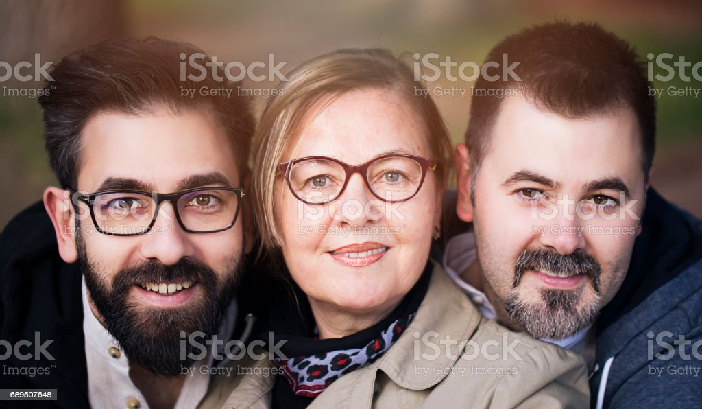 Happy mother and sons stock photo