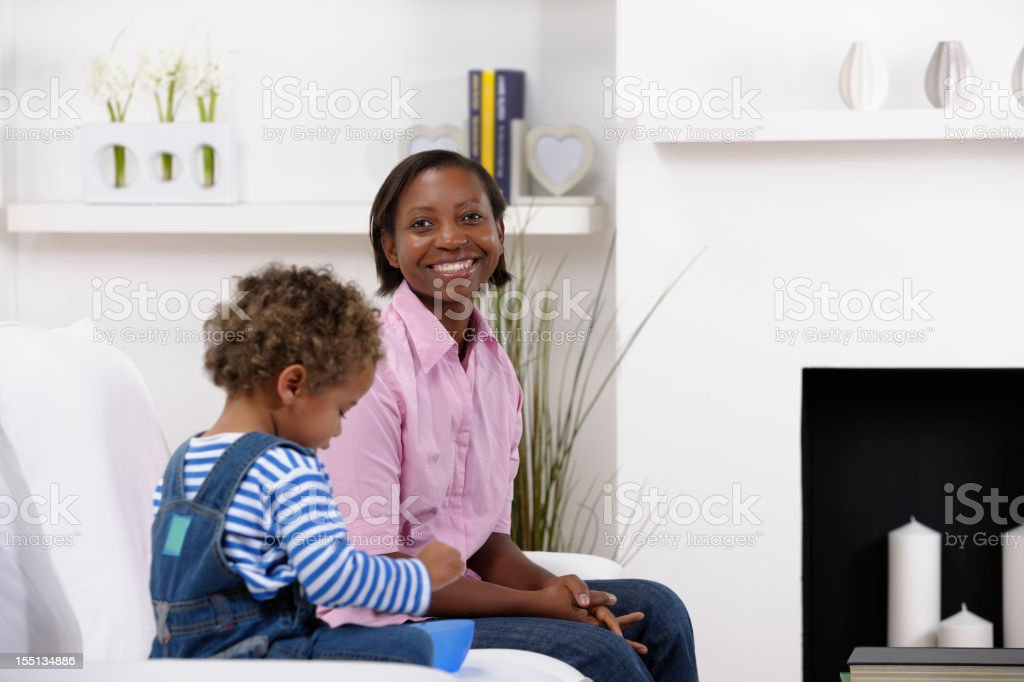 Happy Mother Enjoying Family Time With Her Son royalty-free stock photo