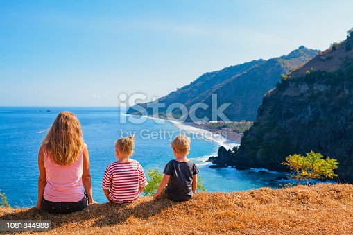 929671306 istock photo Happy mother, kids on hill with sea cliffs scenic view 1081844988