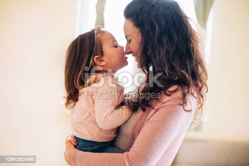 Mother hug her daughter in home