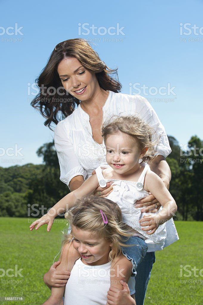 Happy mother playing with her daughters royalty-free stock photo