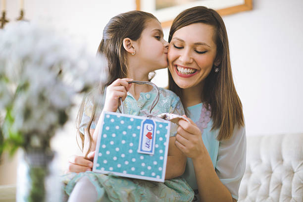 happy mother posing with her daughter - mothers day stock photos and pictures