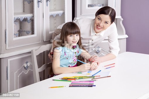 628812970 istock photo Happy mother teach her daughter to paint. 594482158