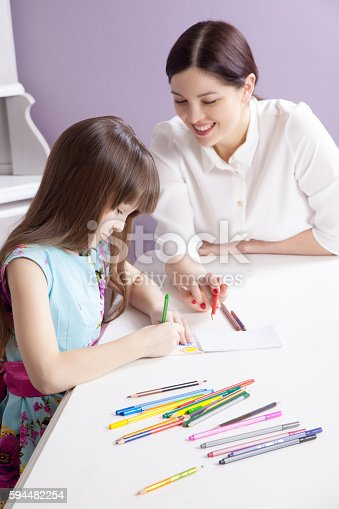 628812970 istock photo Happy mother teach her daughter to paint. 594482254