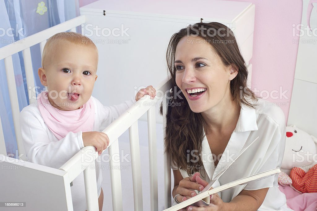 Happy mother together with cute baby royalty-free stock photo