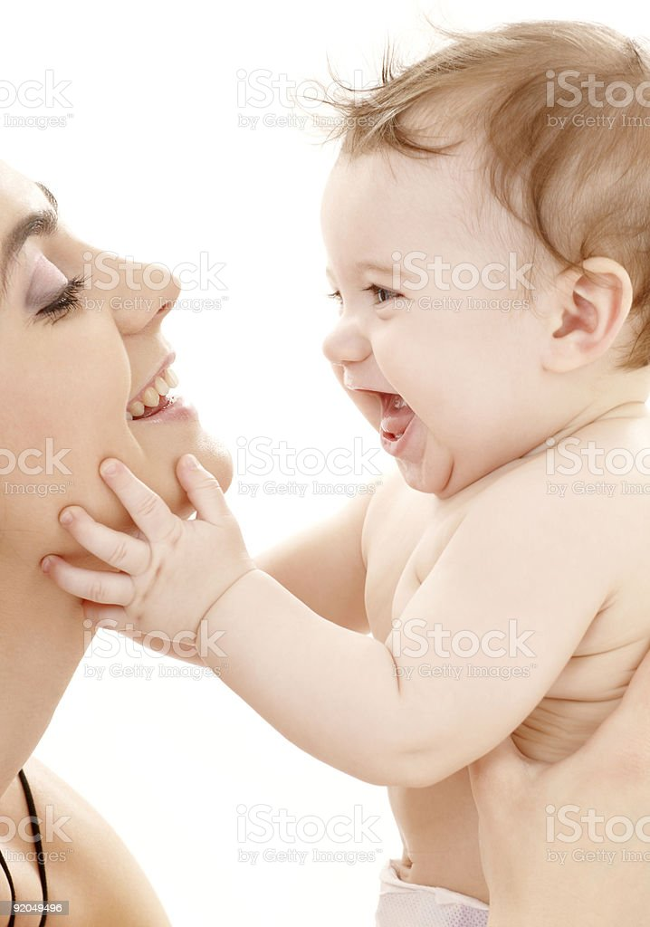 happy mother with baby boy over white stock photo