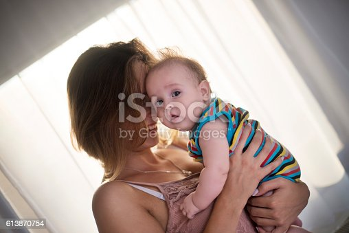 istock Happy mother with baby boy 613870754