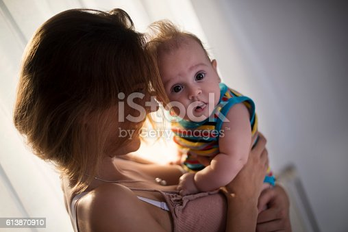 istock Happy mother with baby boy 613870910