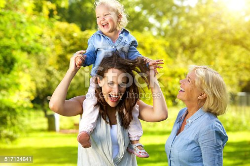 istock Happy mother with child and grandmother 517134641