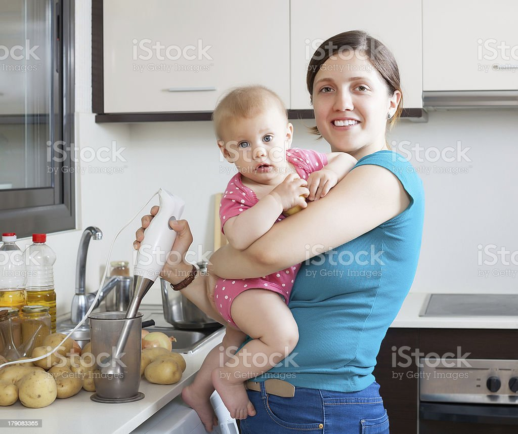 Happy mother with child  in kitchen stock photo