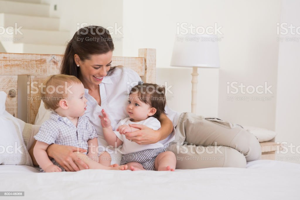 Happy Mother With Cute Babies Boy And Girl Stock Photo More