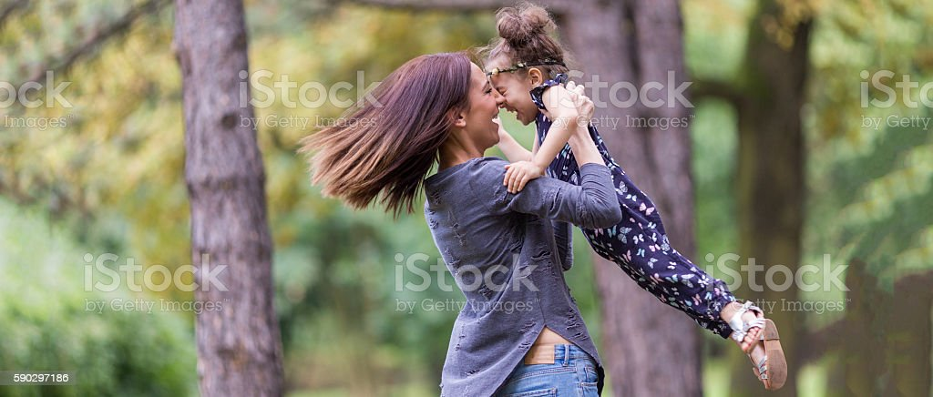 Happy mother with daughter in nature royaltyfri bildbanksbilder