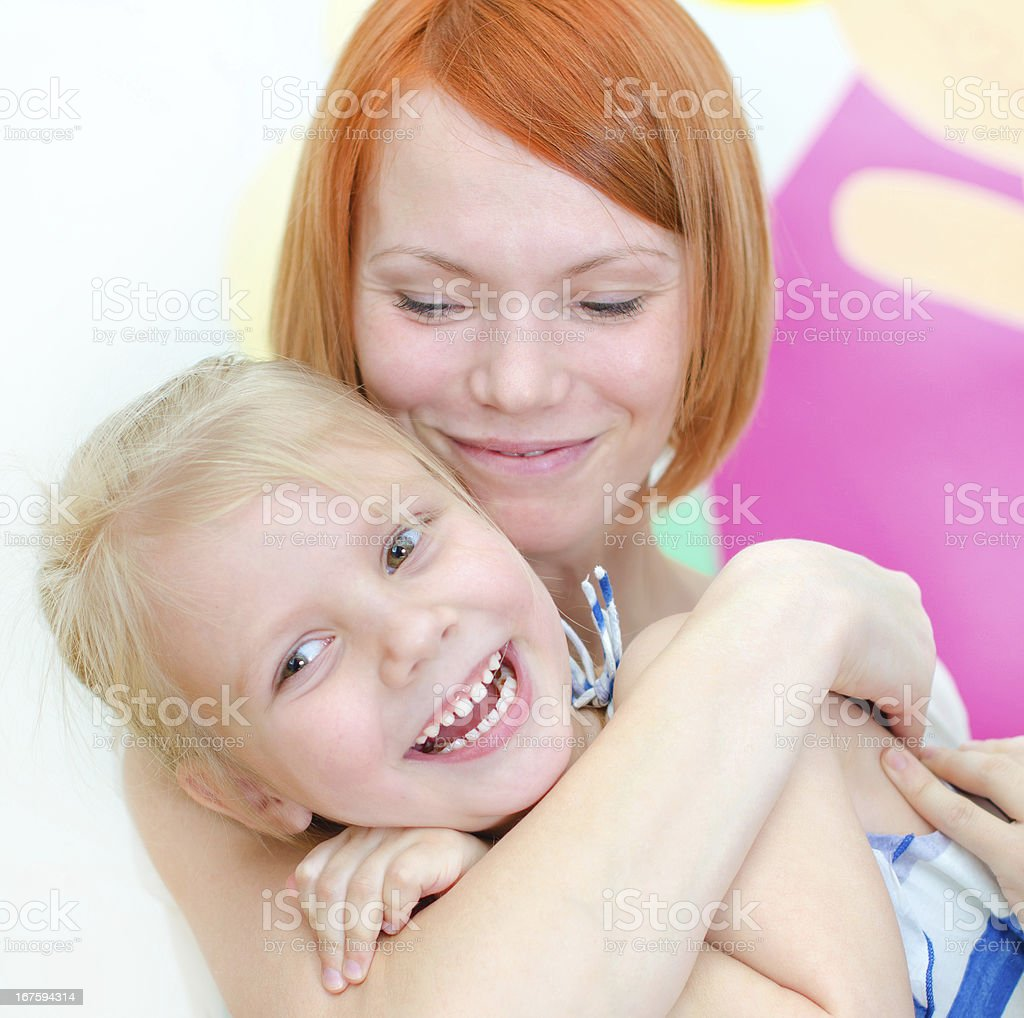 Happy mother with her smiling daughter royalty-free stock photo
