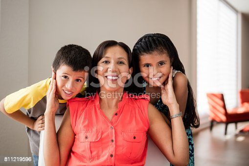 172407626istockphoto Happy mother with her two children smiling at camera 811219596