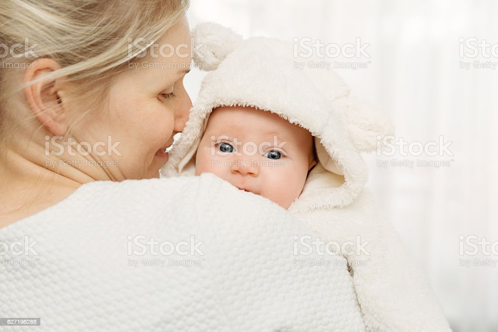 happy mother with infant baby girl dressed in fluffy costume stock photo