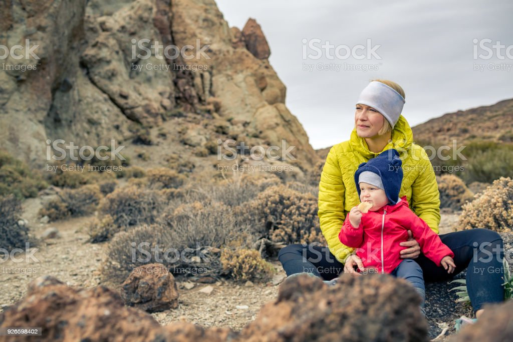 Happy mother with little boy travelling in mountains stock photo