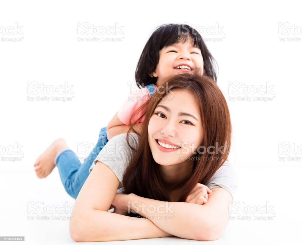 happy mother with little girl playing on the floor stock photo