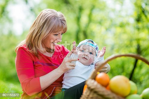 istock Happy mother with son in sunny park 601153372