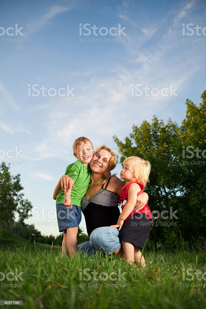 Happy mother with two sons of her smiling royalty-free stock photo