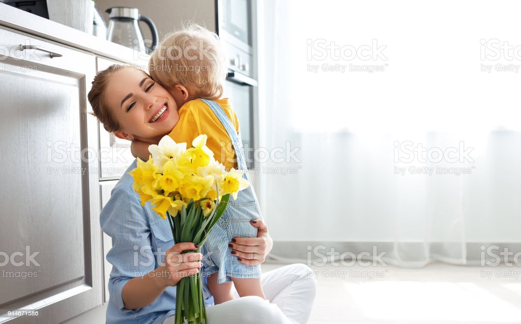 happy mother\'s day! baby son congratulates mother on holiday and...