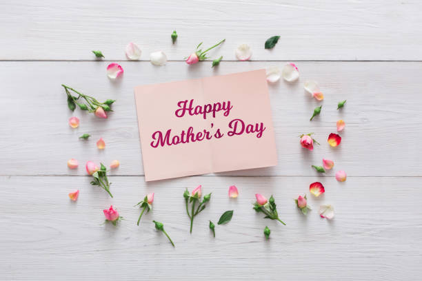 Happy mothers day background card and flowers on white wood picture id921674290?b=1&k=6&m=921674290&s=612x612&w=0&h=vsorbcclrh4ao6fv9delp12dghcovlkeomticwqivue=