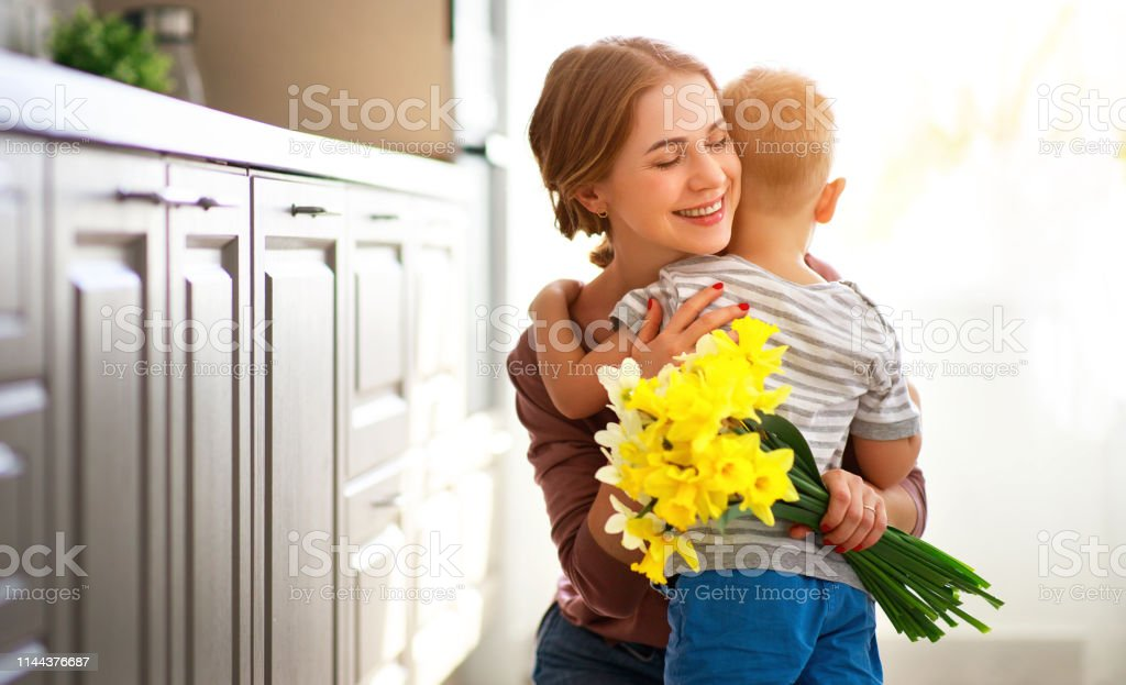 happy mother\'s day! child son congratulates mother on holiday and...