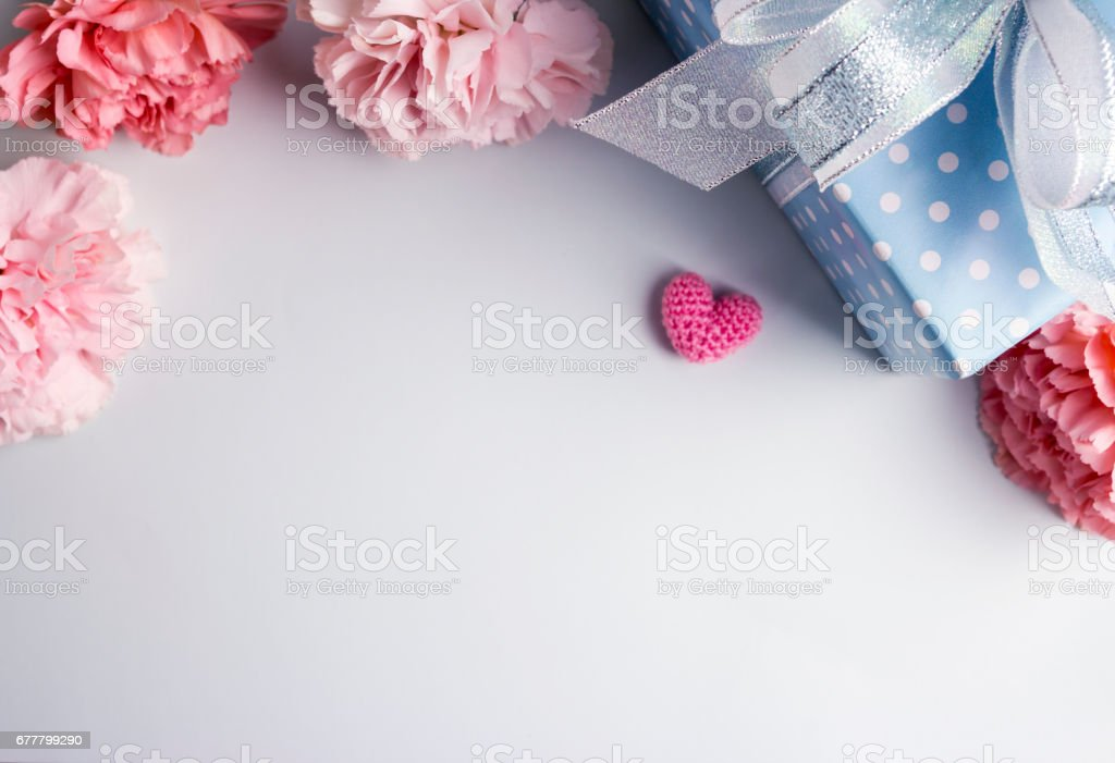 Happy mothers day concept of pink carnation flowers and gift box and...