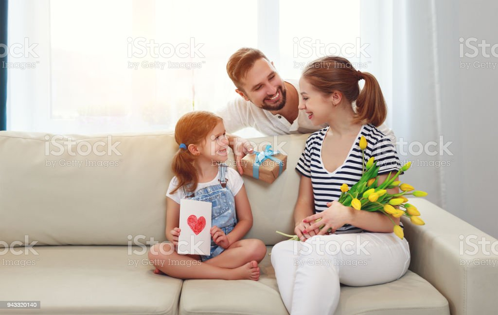 happy mother\'s day! father and child daughter congratulate mother on...
